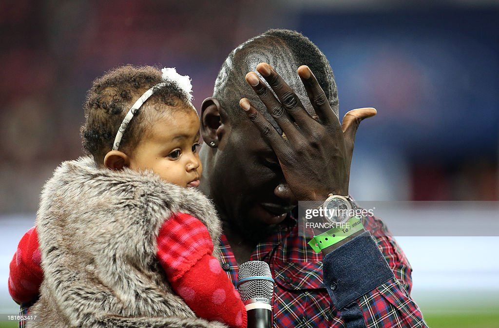 Paris Saint-Germain's former defender Mamadou Sakho delivers a speech before the start of the French L1 football match between Paris Saint-Germain and AS Monaco at the Parc des Princes Stadium in Paris on September 22, 2013.