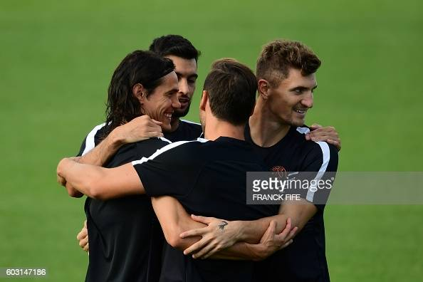 Paris SaintGermain's forward Edinson Cavani and defender Thomas Meunier take part in a training session on the eve of the UEFA Champions League...
