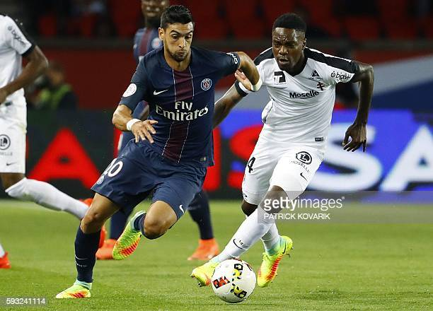 Paris SaintGermain's forward from Argentine Javier Pastore vies for the ball with Metz's French midfielder Renaud Cohade during the French L1...