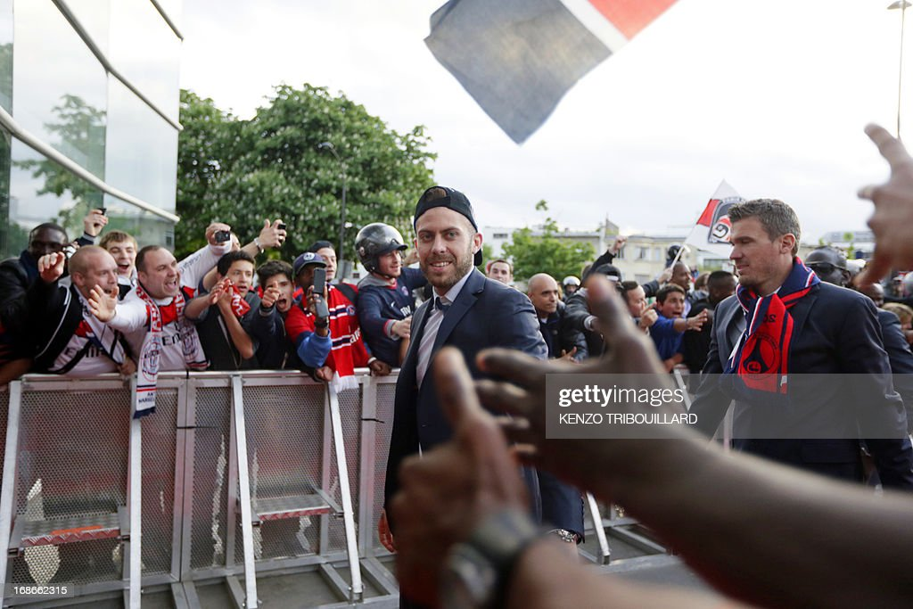 Paris Saint-Germain's forward Jeremy Menez shakes hands with supporters prior to the team's parade to celebrate French L1 football championship title, on May 13, 2013 in Paris. AFP PHOTO / KENZO TRIBOUILLARD