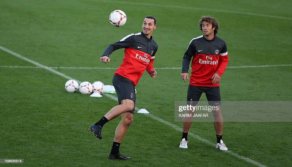 Paris Saint-Germain's (PSG) forward Zlatan Ibrahimovic (L) and player Diego Lugano attend a football training session at the Aspire Academy of Sports Excellence in the Qatari capital Doha on December 31, 2012. PSG is in Qatar for a week-long training camp before the resumption of the French Ligue 1 after the winter break.