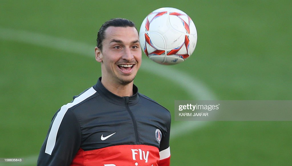 Paris Saint-Germain's (PSG) forward Zlatan Ibrahimovic attends a football training session at the Aspire Academy of Sports Excellence in the Qatari capital Doha on December 31, 2012. PSG is in Qatar for a week-long training camp before the resumption of the French Ligue 1 after the winter break. AFP PHOTO / AL-WATAN DOHA / KARIM JAAFAR == QATAR OUT ==