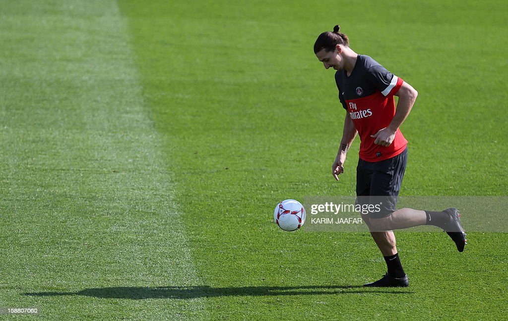 Paris Saint-Germain's (PSG) forward Zlatan Ibrahimovic attends a training session at the Aspire Academy of Sports Excellence in the Qatari capital Doha on December 30, 2012. PSG is in Qatar for a week-long training camp before the resumption of the French Ligue 1 after the winter break.