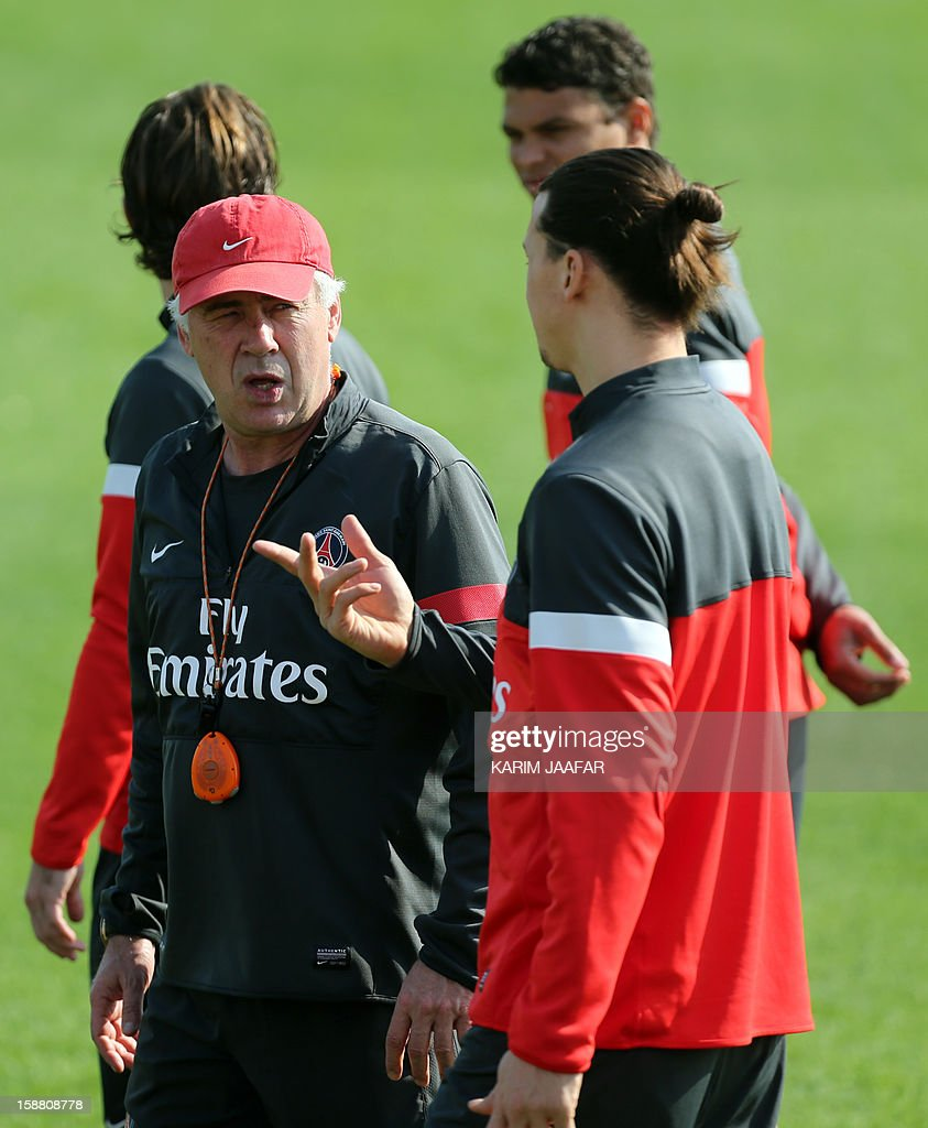 Paris Saint-Germain's (PSG) forward Zlatan Ibrahimovic (R) talks with the football team's Italian coach Carlo Ancelotti (L) during a training session at the Aspire Academy of Sports Excellence in the Qatari capital Doha on December 30, 2012. PSG is in Qatar for a week-long training camp before the resumption of the French Ligue 1 after the winter break.