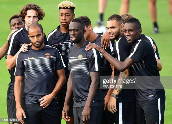 Paris SaintGermain's forwards Lucas Moura and JeanKevin Augustin defender Layvin Kurzawa and midfielder Blaise Matuidi take part in a training...
