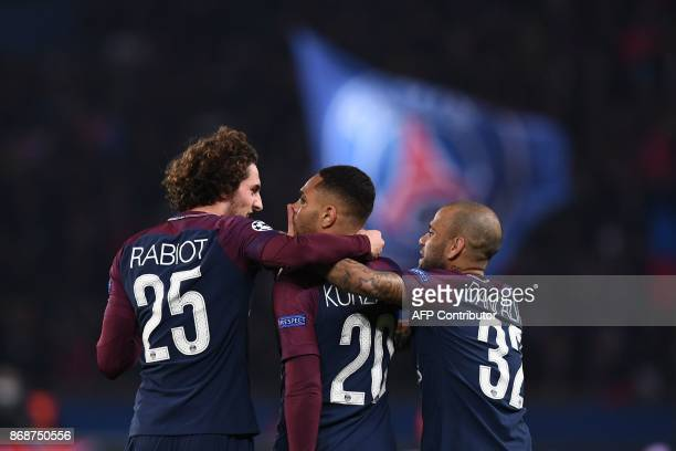 Paris SaintGermain's French defender Layvin Kurzawa celebrates with teammates afters scoring a goal during the UEFA Champions League Group B football...