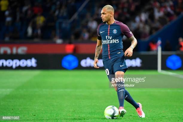 Paris SaintGermain's French defender Layvin Kurzawa drives the ball during the French L1 football match Paris SaintGermain vs Toulouse FC at the Parc...