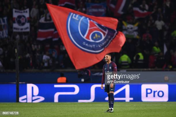 Paris SaintGermain's French defender Layvin Kurzawa reacts after a third goal during the UEFA Champions League Group B football match between Paris...