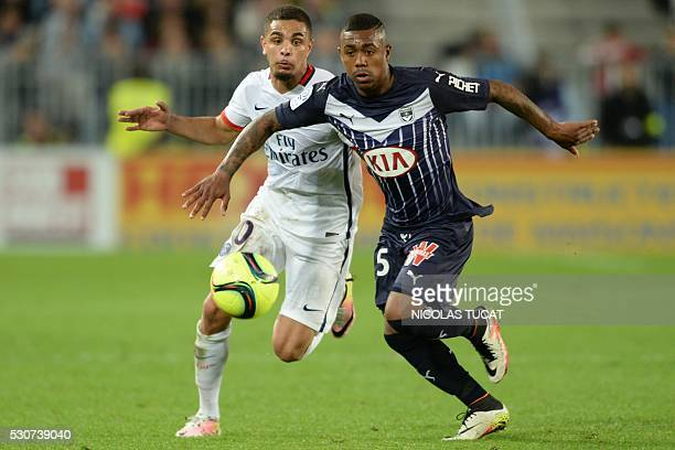 Paris SaintGermain's French defender Layvin Kurzawa vies with Bordeaux' Brazilian forward Malcom during the French L1 football match between Bordeaux...