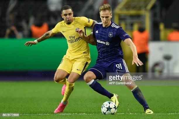 Paris SaintGermain's French defender Layvin Kurzawa vies with Anderlecht's Polish forward Lukasz Teodorczyk during the UEFA Champions League Group B...