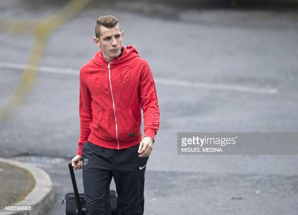 Paris SaintGermain's French defender Lucas Digne arrives for a training session on April 4 2015 at the CampdesLoges in SaintGermainenLaye western...