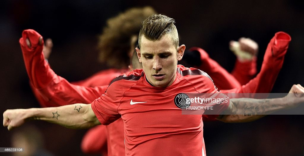 Paris Saint-Germain's French defender <a gi-track='captionPersonalityLinkClicked' href=/galleries/search?phrase=Lucas+Digne&family=editorial&specificpeople=5805298 ng-click='$event.stopPropagation()'>Lucas Digne</a> warms up with teammates ahead of the French Cup quarter-final football match between Paris Saint-Germain (PSG) and Monaco at the Parc des Princes stadium in Paris on March 4, 2015. AFP PHOTO / FRANCK FIFE