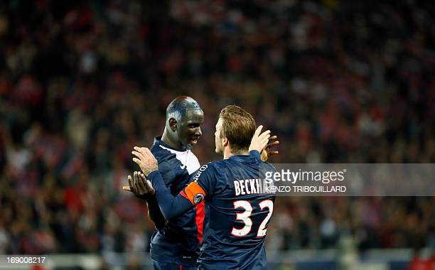 Paris SaintGermain's French defender Mamadou Sakho and Paris SaintGermain's English midfielder David Beckham celebrate a goal during a French L1...