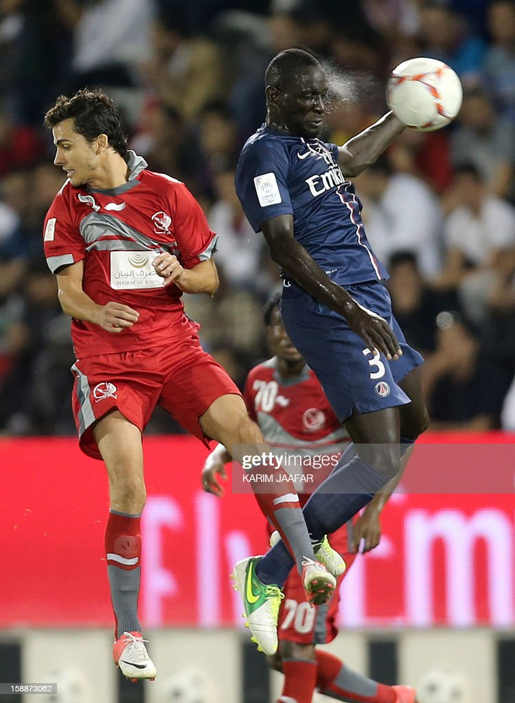 Paris Saint-Germain's French defender Mamadou Sakho (R) challenges Qatar's Lekhwiya Brazilian forward Nilmar Da Silva (L) during a friendly football match in the Qatari capital Doha on January 2, 2013. PSG won 5-1.