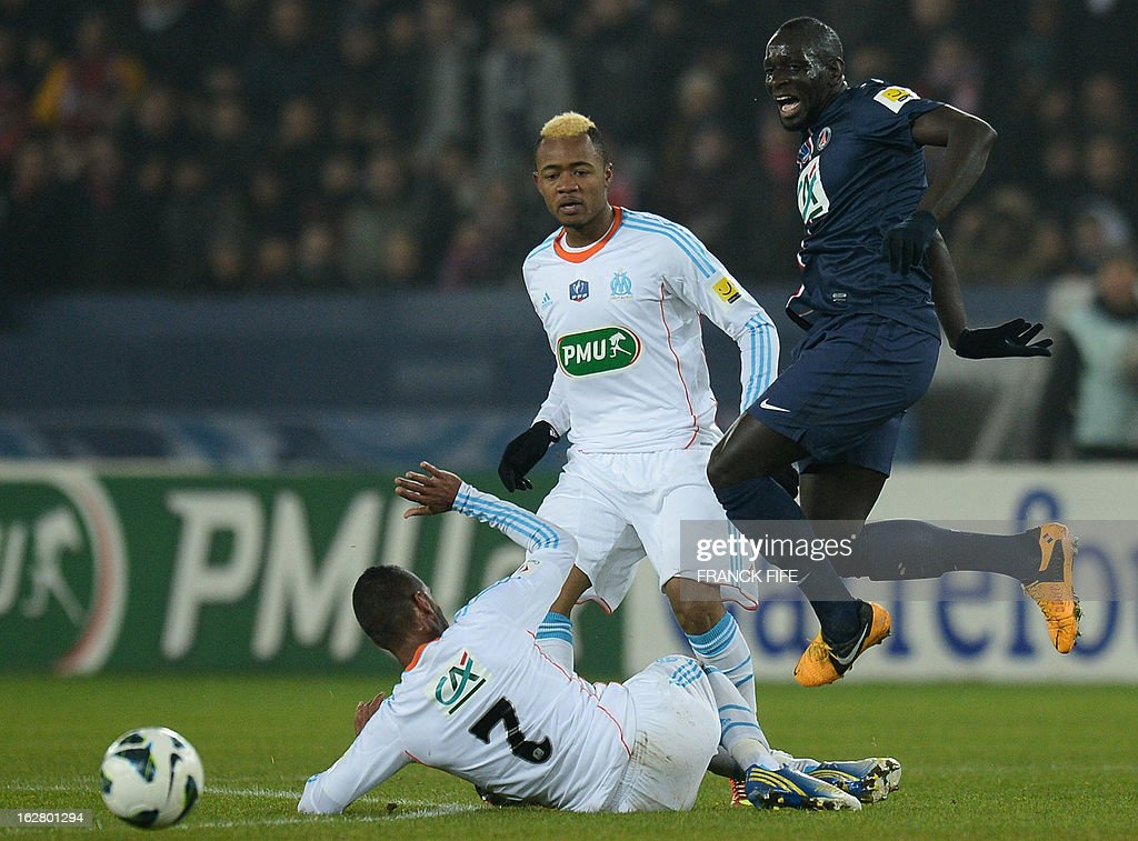Paris Saint-Germain's French defender Mamadou Sakho (R) vies with Marseille's French midfielder Jacques Romao during the French Cup football match Paris Saint-Germain (PSG) vs Olympique de Marseille (OM) on February 27, 2013 at the Parc-des-Princes stadium in Paris.