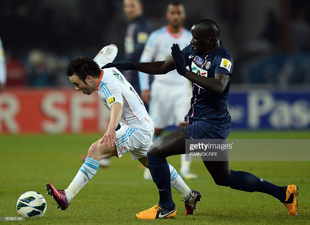 Paris Saint-Germain's French defender Mamadou Sakho (R) vies with Marseille's French midfielder Mathieu Valbuena during the French Cup football match Paris Saint-Germain (PSG) vs Olympique de Marseille (OM) on February 27, 2013 at the Parc-des-Princes stadium in Paris.