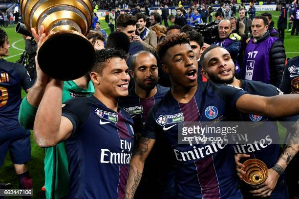 Paris SaintGermain's French defender Presnel Kimpembe and Paris SaintGermain's Brazilian defender Thiago Silva celebrate after winning the French...