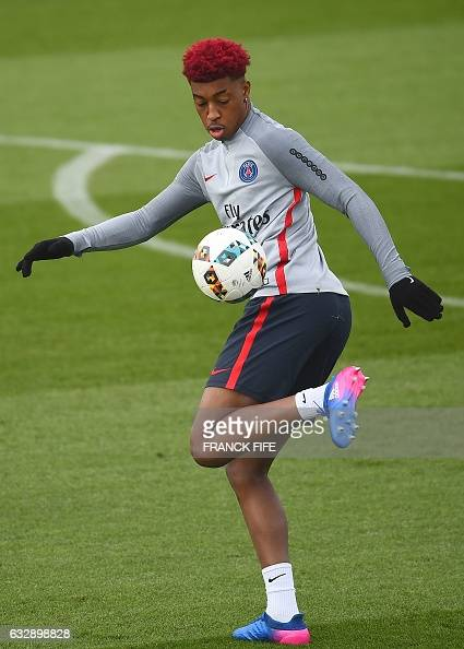 Paris SaintGermain's French defender Presnel Kimpembe controls the ball during a training session on January 28 2017 in SaintGermainenLaye western...