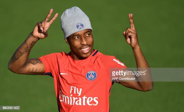Paris SaintGermain's French defender Presnel Kimpembe make V signs before a training session on October 12 2017 at the Oredoo training center in...