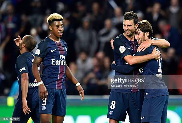 Paris SaintGermain's French defender Presnel Kimpembe Paris SaintGermain's Italian midfielder Thiago Motta and Paris SaintGermain's Brazilian...