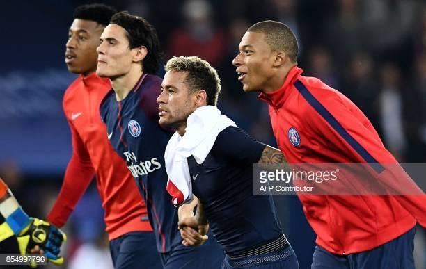 Paris SaintGermain's French defender Presnel Kimpembe Paris SaintGermain's Uruguayan forward Edinson Cavani Paris SaintGermain's French forward...