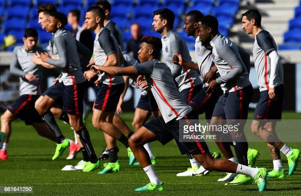 Paris SaintGermain's French defender Presnel Kimpembe stretches during a training session at the Parc Olympique Lyonnais stadium in DecinesCharpieu...
