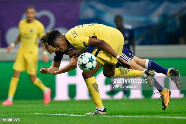 Paris SaintGermain's French defender Presnel Kimpembe vies for the ball with Anderlecht's Belgian midfielder Pieter Gerkens during the UEFA Champions...