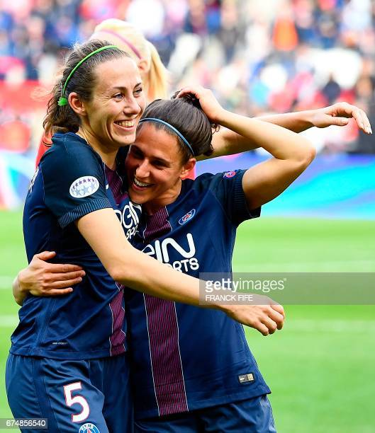 Paris SaintGermain's French defender Sabrina Delannoy and Paris SaintGermain's spanish midfielder Veronica Boquete celebrate their victory at the end...