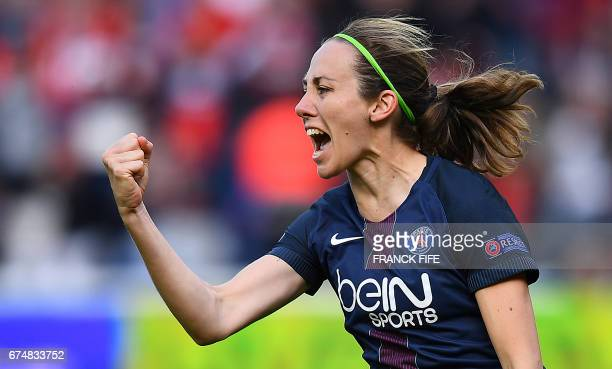 Paris SaintGermain's French defender Sabrina Delannoy celebrates scoring the opening goal during the UEFA Women's Champions League semifinal second...