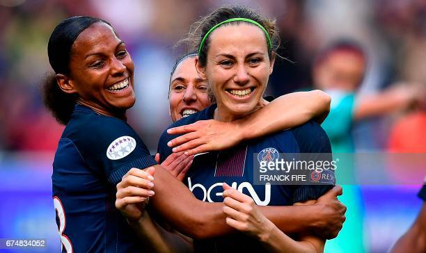 Paris SaintGermain's French defender Sabrina Delannoy celebrates scoring the opening goal with Paris SaintGermain's forward MarieLaure Delie during...