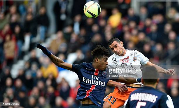 Paris SaintGermain's French forward Christopher Alan Nkunku and Monpellier's French midfielder Ellyes Skhiri jump for the ball during the French L1...
