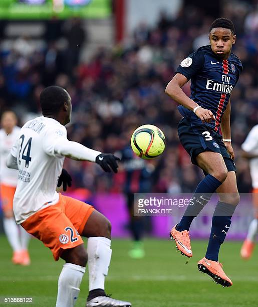 Paris SaintGermain's French forward Christopher Alan Nkunku vies for the ball with Montpellier's French forward Jerome Roussillon during the French...