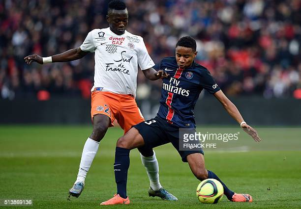 Paris SaintGermain's French forward Christopher Alan Nkunku vies for the ball with Montpellier's Chadian forward Casimir Ninga during the French L1...