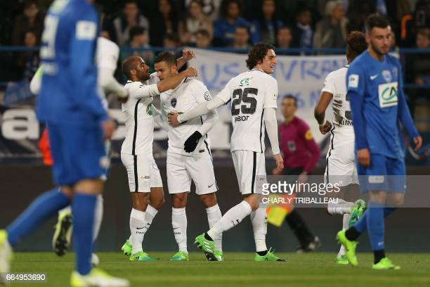 Paris SaintGermain's French forward Hatem Ben Arfa celebrates with teammates after scoring during the French Cup football match between Avranches and...