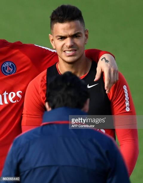 Paris SaintGermain's French forward Hatem Ben Arfa looks at Spanish head coach Unai Emery during a training session on October 12 2017 at the Oredoo...