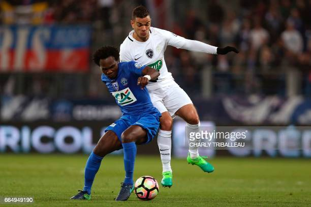 Paris SaintGermain's French forward Hatem Ben Arfa vies for the ball with Avranches' midfielder Charles Boateng during the French Cup football match...