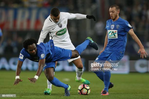 Paris SaintGermain's French forward Hatem Ben Arfa vies for the ball with Avranches' midfielder Charles Boateng and Avranches' defender Sylvestre...
