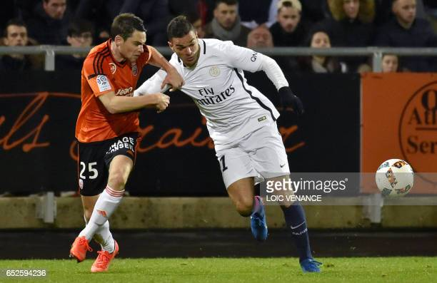 Paris SaintGermain's French forward Hatem Ben Arfa vies with Lorient's French defender Vincent Le Goff during the French L1 football match Lorient vs...