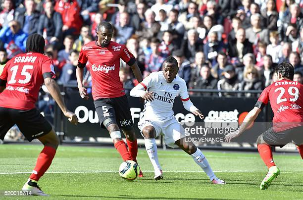 Paris SaintGermain's French forward Hervin Ongenda vies with opponents during the French L1 football match Guingamp vs Paris SG at the Roudourou...