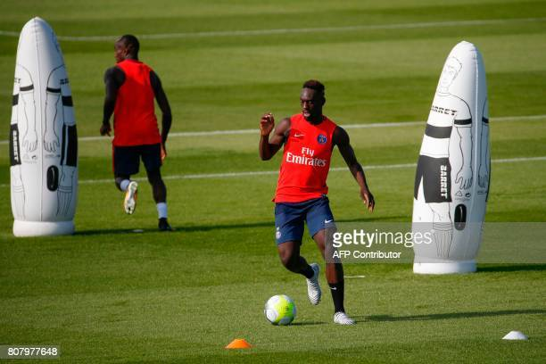 Paris SaintGermain's French forward JeanKevin Augustin takes part in a training session at the Oredoo training Centre in SaintGermainenLaye on July 4...
