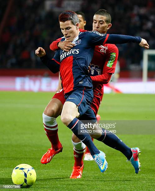 Paris SaintGermain's French forward Kevin Gameiro runs with the ball during a French L1 football match between Paris St Germain and Brest on May 18...