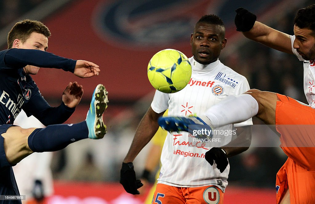 Paris Saint-Germain's French forward Kevin Gameiro (L) vies with Montpellier's Brazilian defender Vitorino Hilton (R) in front Montpellier's Cameroonian defender Henri Bedimo (C) during the French L1 football match Paris Saint-Germain (PSG) vs Montpellier, on March 29, 2013 at the Parc des Princes stadium in Paris.