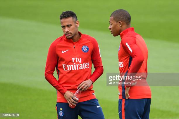 Paris SaintGermain's French forward Kylian Mbappe and Paris SaintGermain's Brazilian forward Neymar speak during a training session at the Ooredoo...