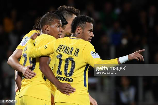 Paris SaintGermain's French forward Kylian Mbappe and Paris SaintGermain's Brazilian forward Neymar celebrate with teammates after a goal during the...