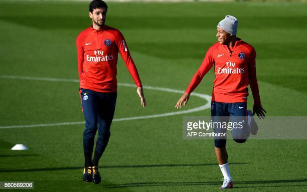 Paris SaintGermain's French forward Kylian Mbappe and Paris SaintGermain's Argentinian forward Javier Pastore take part in a training session on...