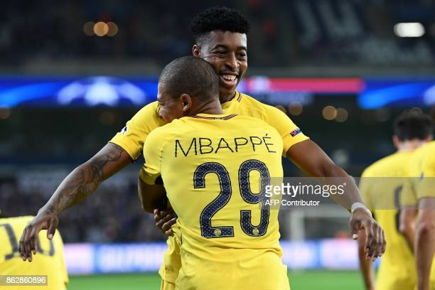 Paris SaintGermain's French forward Kylian Mbappe celebrates after scoring a goal with Paris SaintGermain's France defender Presnel Kimpembe during...