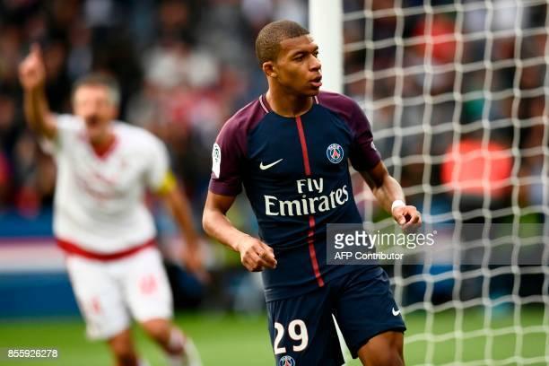 Paris SaintGermain's French forward Kylian Mbappe celebrates after scoring his team's 6th goal during the French L1 football match Paris SaintGermain...