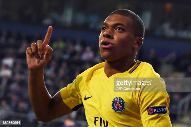 Paris SaintGermain's French forward Kylian Mbappe celebrates after scoring during the UEFA Champions League Group B football match between RSC...