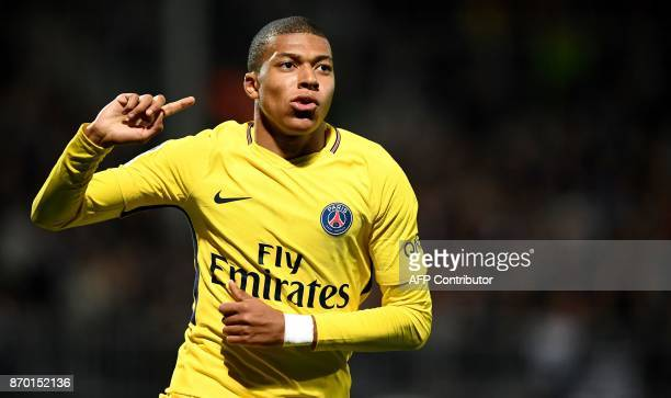 Paris SaintGermain's French forward Kylian MBappe celebrates after scoring during the French L1 football match between Angers and Paris SaintGermain...