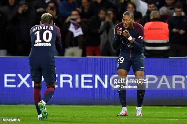 Paris SaintGermain's French forward Kylian Mbappe celebrates with Paris SaintGermain's Brazilian forward Neymar after scoring the team's second goal...